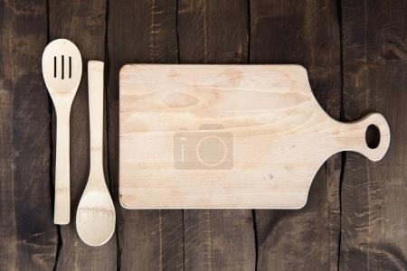 Chopping board with kitchen utensils