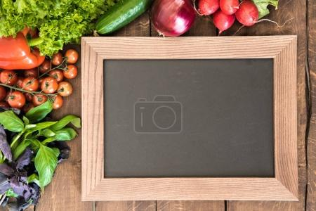 Photo for Overhead view of blank chalkboard with group of fresh vegetables for cooking breakfast. Enjoy your meal concept - Royalty Free Image