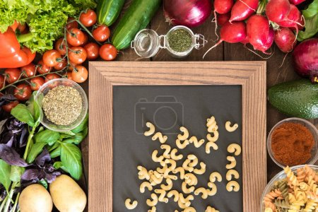 food background with vegetables and pasta