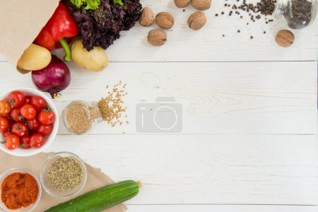 Photo for Top view of fresh raw vegetables and spices on wooden table - Royalty Free Image
