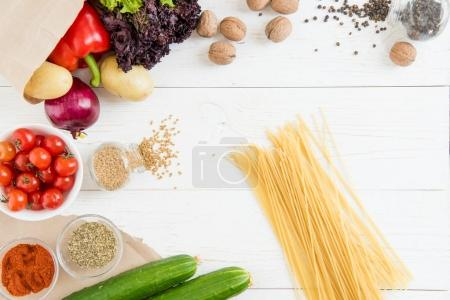 Raw spaghetti and vegetables