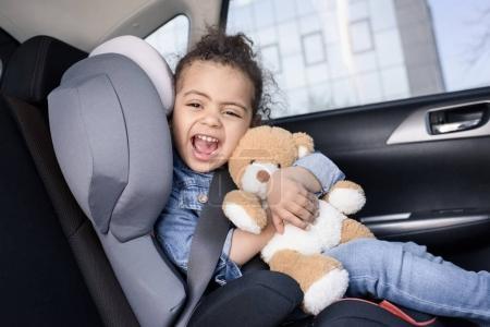 little girl in car
