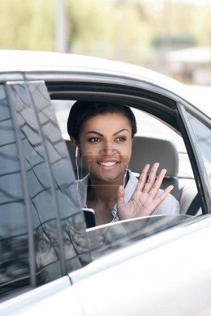 Beautiful woman sitting in car