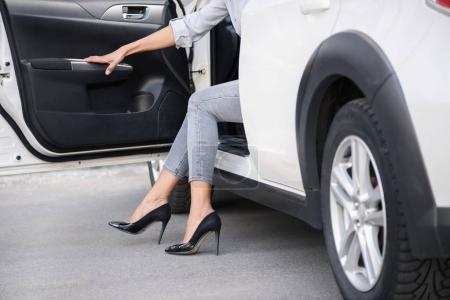 woman going out of car