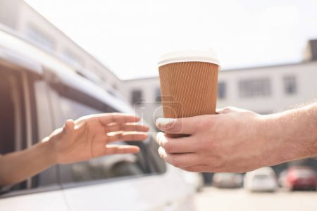 Photo for Partial view of woman sitting in car and buying coffee to go - Royalty Free Image