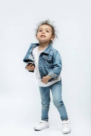 funny little kid girl in jeans