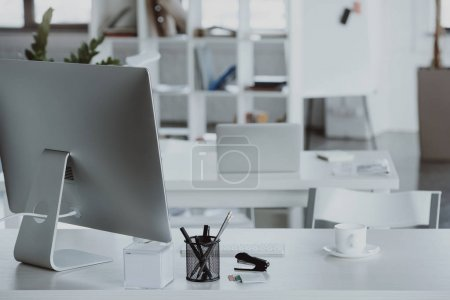 Photo for Workplace with computer monitor, coffee cup and office supplies in office - Royalty Free Image