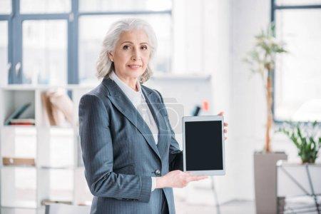 Senior businesswoman with digital tablet