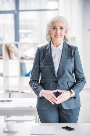 Senior businesswoman at workplace
