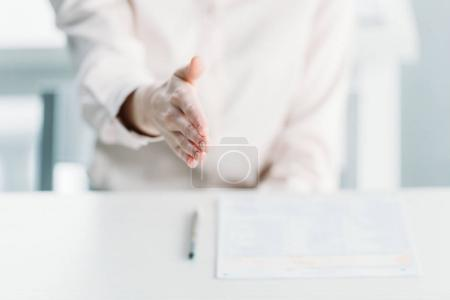 businesswoman with document on tabletop
