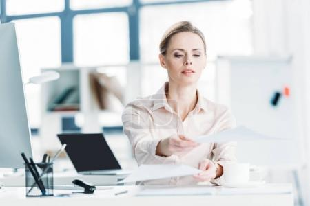 businesswoman working with documents at office