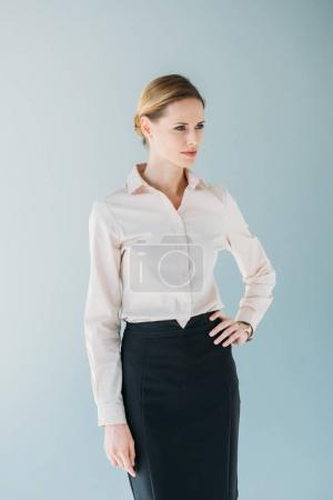 caucasian businesswoman posing and looking aside