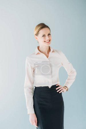 Photo for Portrait of young attractive caucasian businesswoman in formalwear smiling, isolated on grey - Royalty Free Image
