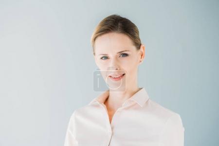 caucasian businesswoman in formalwear smiling