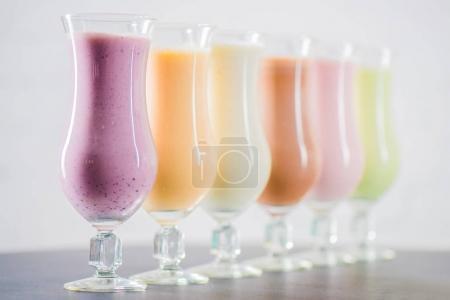 Delicious milkshakes in glasses