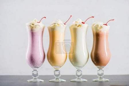 various sweet milkshakes in glasses