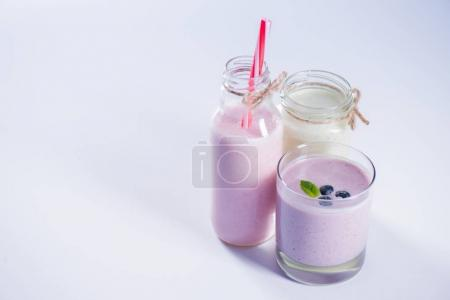 fresh berry milkshakes in glassware