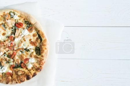 italian pizza on baking paper