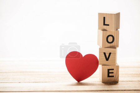 Heart with love sign on wooden cubes