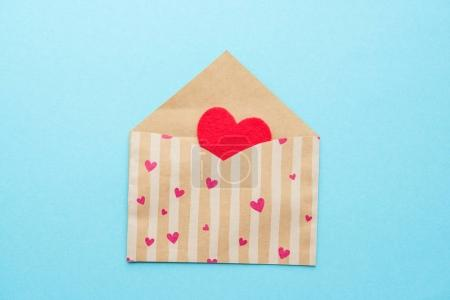 Open envelope with red heart