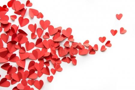 Photo for Festive background made from heap of red hearts decoration isolated on white - Royalty Free Image