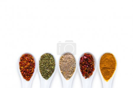Photo for Top view of assorted aromatic spices in ceramic spoons isolated on white - Royalty Free Image