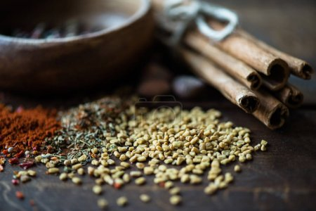 scattered sesame seeds and herbs with cinnamon