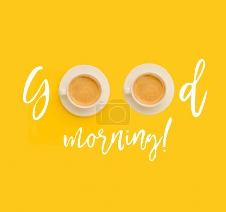 Photo for Inscription Good morning with cups of fresh hot coffee on yellow background - Royalty Free Image