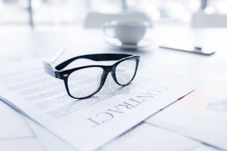 Eyeglasses and business contract