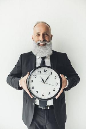 mature businessman with clock