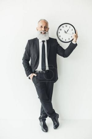 mature businessman with clock