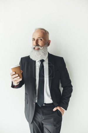 businessman with paper cup of coffee