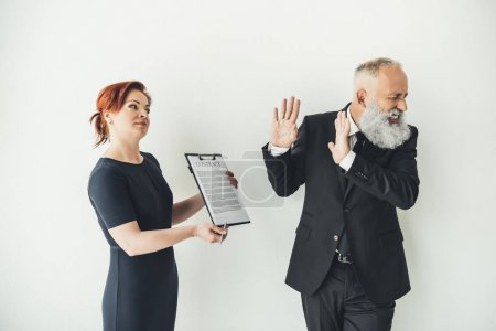 businessman refusing to sign contract