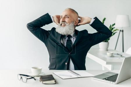Relaxed senior businessman
