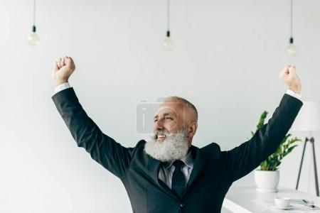 businessman with raised hands