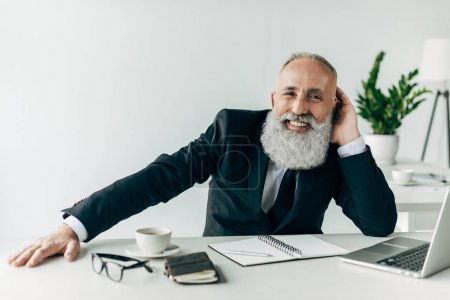 relaxed senior businessman at workplace