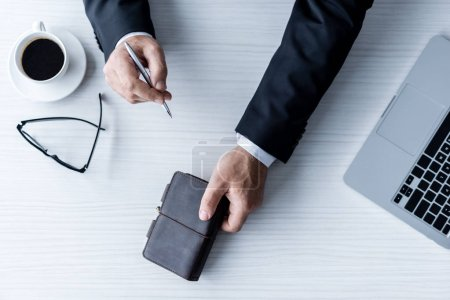 Businessman with pen and notebook