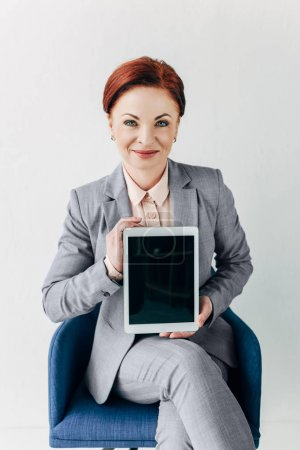 businesswoman showing blank tablet