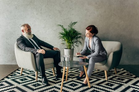 Business partners conversing in office