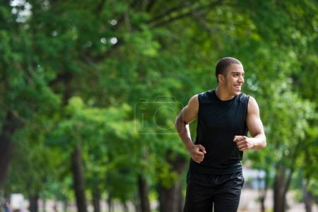 african american sportsman running in park