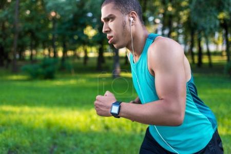 african american sportsman running in park
