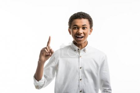 African american teenager pointing with finger up