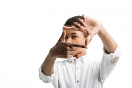 african american teenager making frame with hands