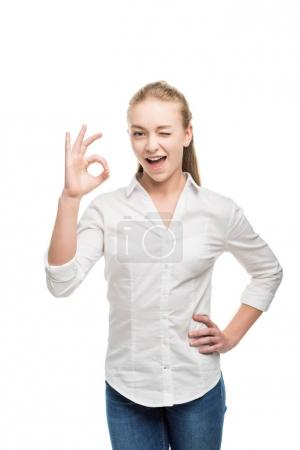 caucasian teenage girl showing ok sign