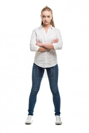 caucasian teenage girl with arms crossed