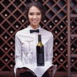 Постер, плакат: Sommelier with wine in cellar