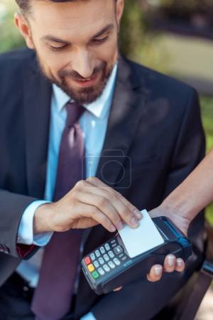 man using contactless credit card