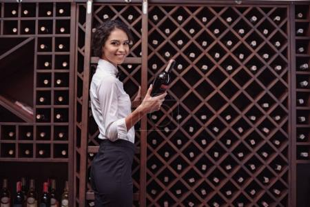 sommelier in wine cellar