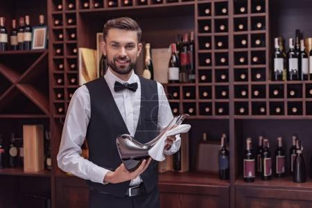 sommelier holding decanter with wine