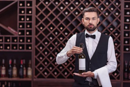 sommelier with bottle of wine